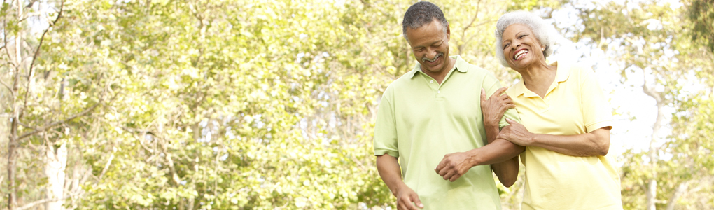 A healthy couple walking after care from their orthopedic provider.